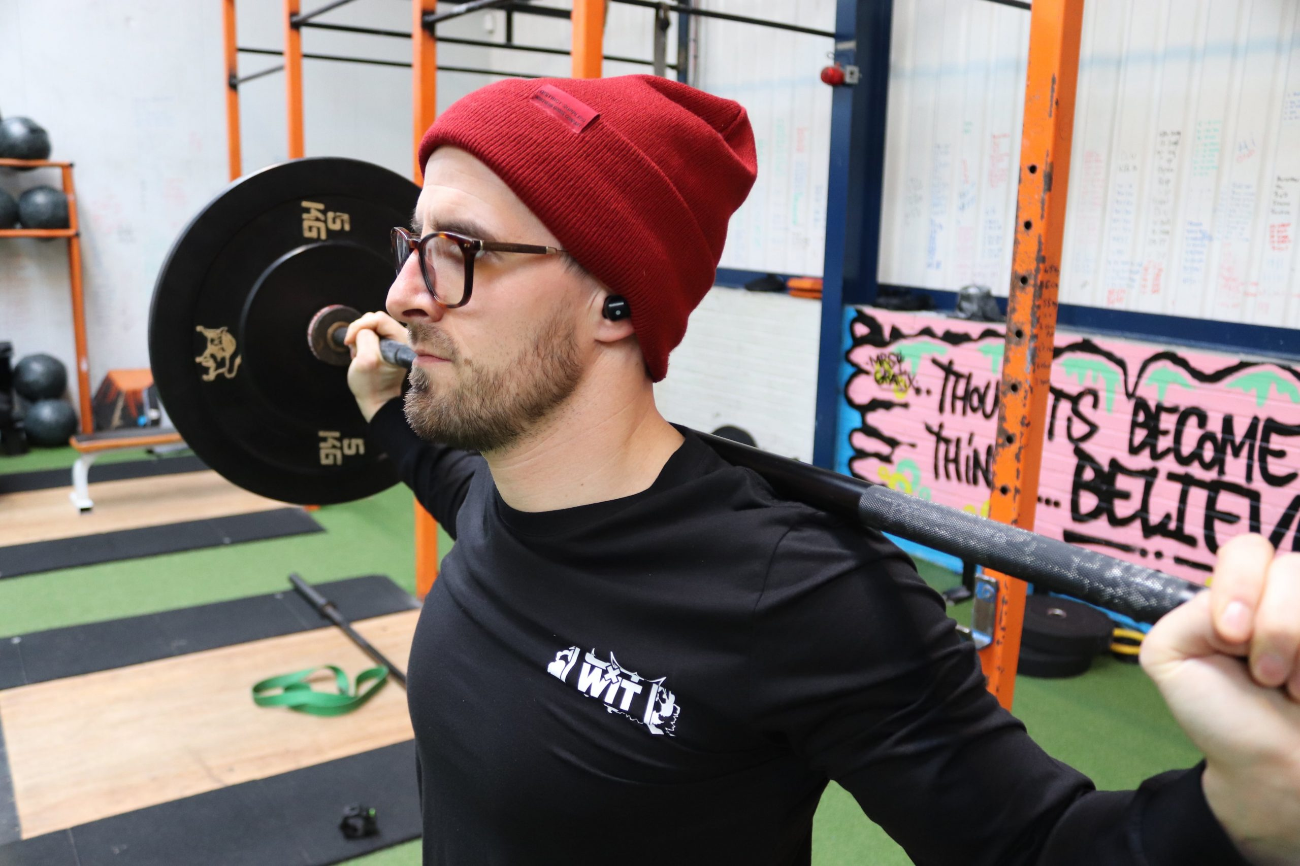 Male working out wearing SOS Sounds True Wireless Earbuds